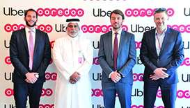Senior Ooredoo and Uber executives mark the partnership.
