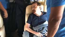 Former far-left Italian militant Cesare Battisti sitting aboard a plane chartered by the Italian gov