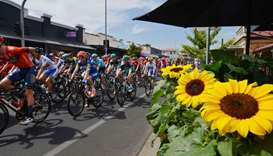 The peleton rides through the suburb of Prospect during stage