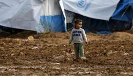 A Syrian child stands out in the open in Abu Al-Khashab camp for the displaced from the eastern prov