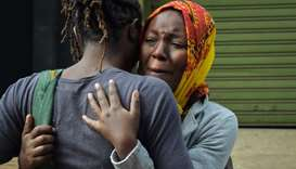 A woman cries in the arms of a relative in Nairobi, while identifying the bodies of the victims afte