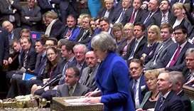British Prime Minister Theresa May speaks after winning a confidence vote, after Parliament rejected