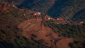 Rescue workers continue efforts to find a boy who fell down a well in Totalan in southern Spain