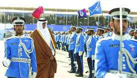 His Highness the Amir Sheikh Tamim bin Hamad al-Thani reviews a guard of honour during the graduatio