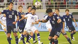 Japan forward Koya Kitagawa (R)