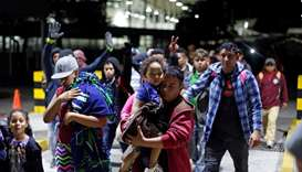 People belonging to a caravan of migrants from Honduras en route to the United States, walk at the b
