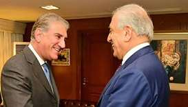 Pakistan's Foreign Minister Shah Mahmood Qureshi (L) meets with US envoy Zalmay Khalilzad -- the US