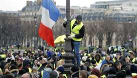 Protesters wearing yellow vests take part in a demonstration by the 'yellow vests' movement, in Pari
