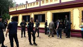 Police investigators inspect Rattanaupap temple in Narathiwat province following an attack by black-