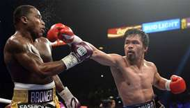 Manny Pacquiao (black trunks) and Adrien Broner (purple/gold trunks) box during a WBA welterweight w