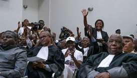 UDPS lawyers, representing Felix Tshisekedi, celebrate following the pronouncement of the judges of