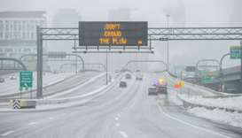 Ice and snow cover Interstate 93 through the city during Winter Storm Harper in Boston