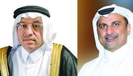 Masraf Al Rayan chairman and managing director Dr Hussain al-Abdulla (L), Group chief executive offi