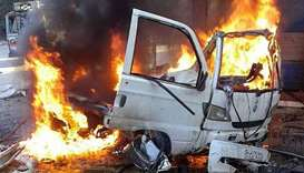 A burning vehicle in the Syrian regime's coastal stronghold of Latakia.
