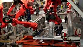 Robots work on the cab of a 2019 Ram pickup truck at the Fiat Chrysler Automobiles (FCA) Sterling He