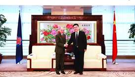 Al-Baker shakes hands with a top China Southern Airlines official after signing an agreement.