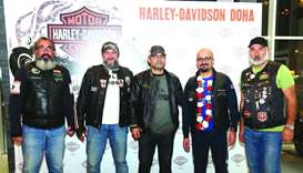 Qatari biker Khaled al-Jaber (2nd, right) with Harley Owners Group – Qatar officials