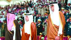 His Highness the Amir Sheikh Tamim bin Hamad al-Thani reviews a parade by graduates of the sixth bat