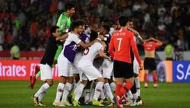 Qatar's players celebrate their win during the 2019 AFC Asian Cup quarter-final football match betwe