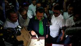 Ebrahim Murad, Chairman of the Moro Islamic Liberation Front (MILF), casts his vote during the plebi