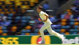 Australia's Pat Cummins bowls during the third day of the day-night Test cricket match between Austr