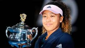 Japan's Naomi Osaka celebrates with the championship trophy during the presentation ceremony after h