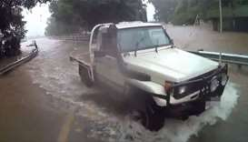 A vehicle on a flooded road in Queensland