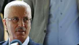 Palestinian PM willing to quit if president Abbas wishes