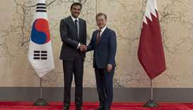 His Highness the Amir Sheikh Tamim bin Hamad Al-Thani shakes hand with South Korean President Moon J