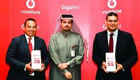 Vodafone Qatar chief executive officer Sheikh Hamad Abdulla Jassim al-Thani (centre) with Camberos (