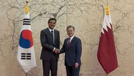 His Highness the Amir Sheikh Tamim bin Hamad al-Thani and South Korean President Moon Jae-in shake h