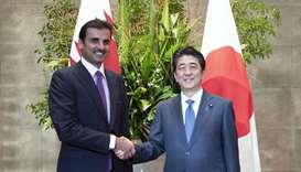 His Highness the Amir Sheikh Tamim bin Hamad Al-Thani shakes hand with Shinzo Abe, the Prime Ministe