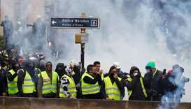 French 'yellow vests' keep up pressure on unrepentant Macron