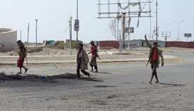 Members of the Yemeni pro-government forces gather at the eastern entrance of the port city of Hodei