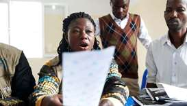 An official of Congo's Independent National Electoral Commission reads out the presidential election