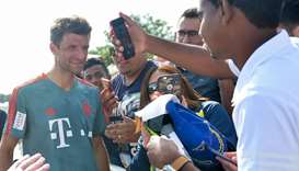 Football fans click pictures of Bayern Munich vice captain Thomas Muller during the German football