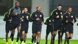 AFC Player of the Year Abdelkarim Hassan (L) trains with his Qatari teammates in Abu Dhabi Monday