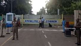 Police stand guard outside a copper smelter controlled by London-listed Vedanta Resources in Thoothu