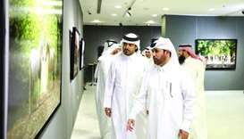 "Dr Khalid bin Ibrahim al-Sulaiti and photographer Omar al-Hammadi at the inauguration of ""Al Adiyat"""