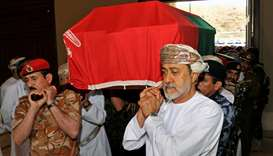 Oman's newly sworn-in Sultan Haitham bin Tariq al-Said carries the coffin of the late Sultan Qaboos,