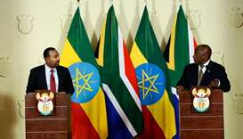 South African President Cyril Ramaphosa (R) and Prime Minister of Ethiopia Abiy Ahmed Ali (L) hold a