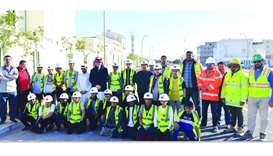 Students with officials and CMC member Hamad Abdullah Hamad Abdullah al-Hinzab