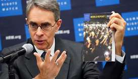 Kenneth Roth, the Executive Director of Human Rights Watch holds up their World Report 2020 at the U