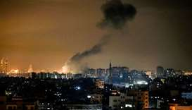 Smoke rises following an Israeli air strike on Gaza City, yesterday.