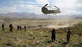 US military Chinook helicopter lands on a field outside the governor's palace during a visit by the