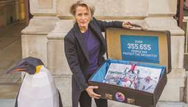 Actress Gillian Anderson delivering a Greenpeace petition to the Foreign Office in London in 2018.