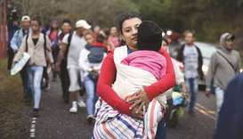 Honduran migrants walk in a caravan heading to the US, near Quezaltepeque, Chiquimula department, Gu