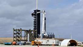New construction surrounds the SpaceX Crew Dragon capsule atop a Falcon 9 booster rocket on historic