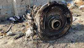 Iran aims to examine downed plane's black boxes, no plan yet to send them abroad