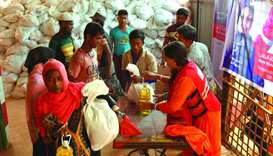 QRCS distributes food aid to Myanmar refugees in Bangladesh